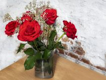 Beautiful bunch of red roses with water driops. stock photo