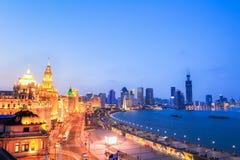 Beautiful the bund of shanghai in nightfall. Shanghai the bund at nightfall, beautiful outstanding historical buildings Stock Image