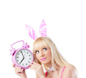 Beautiful in bunny ears holding clock Stock Image