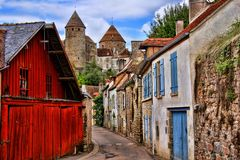 Beautiful Burgundy street with ancient towers, France Stock Photo
