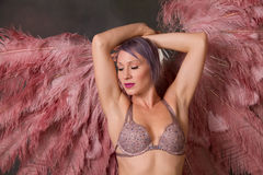 Beautiful burlesque dancer with feather fans Royalty Free Stock Photos