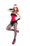 Beautiful burlesque girl in red corset and Santa Claus hat Royalty Free Stock Photo
