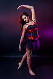 Beautiful burlesque woman in black and red corset Stock Photography