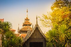 Beautiful Burmese style Buddhist church in Wat Chedi Luang, Chiang Mai, Thailand. Many of the regions temples are built in Lanna,. Thai, and Burmese style stock photo
