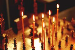 Beautiful burning candles in the temple royalty free stock photo