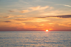 Beautiful burning sky at sunrise beach in the morning time Stock Photos