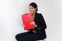 Beautiful Business Girl In Black Suit Smiling With Portfolio Stock Photos