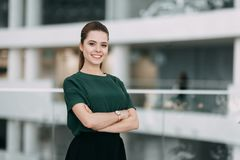 Beautiful business lady. At work with a laptop and phone sitting in the office Royalty Free Stock Photography