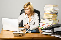 Beautiful Business Lady at Desk Royalty Free Stock Photography