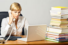 Beautiful Business Lady at Desk Stock Images