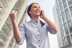 Beautiful business lady with gadget Royalty Free Stock Images