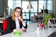 Beautiful Business Lady in official clothing working on Laptop Stock Photography