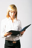 Beautiful Business Lady Reading Royalty Free Stock Photography