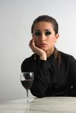 Beautiful business lady in a restaurant celebrating with red wine Stock Photography