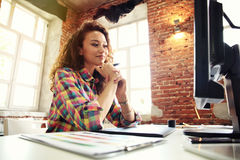 Beautiful business lady smiling while working in office. Royalty Free Stock Photos