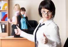 Beautiful business lady with thumb up gesture Stock Photos