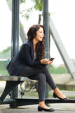 Beautiful business lady waiting at bus stop Stock Images