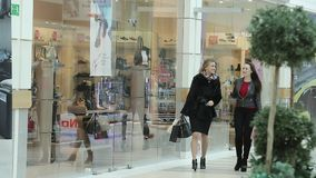 Beautiful business lady walk around the Mall after shopping. Two attractive business lady walk around the Mall after shopping. Filmed in the city of Togliatti stock footage