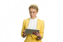 Beautiful business lady working on pc tablet. Close up of concentrated young business woman using computer tablet isolated on white background Royalty Free Stock Photography