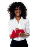 Beautiful business professional making notes Royalty Free Stock Photography