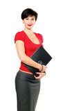 Beautiful business woman. Portrait of beautiful business woman in red sweater holding a folder royalty free stock images