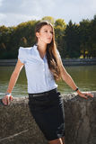 Beautiful business woman. A business woman standing by river in Minsk Stock Photos