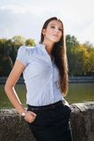 Beautiful business woman. A business woman standing by river in Minsk Stock Image