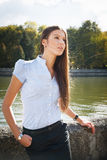 Beautiful business woman. A business woman standing by river in Minsk Royalty Free Stock Photos