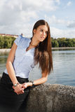 Beautiful business woman. A business woman standing by river in Minsk Stock Photography