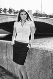 Beautiful business woman. Portrait of a beautiful business woman on the bank of the river Royalty Free Stock Images