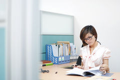 Beautiful business woman. Is working at the office Stock Photography