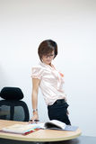Beautiful business woman. Is working at the office royalty free stock image