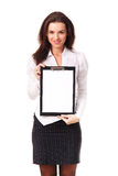 Beautiful business woman. Beautiful Hispanic business woman with blank page on clip board facing camera Stock Images