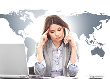 Beautiful business woman answering international calls Royalty Free Stock Images