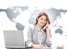 Beautiful business woman answering international calls Stock Image