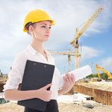 Beautiful business woman architect in yellow builder helmet Stock Image