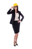 Beautiful business woman architect in yellow helmet isolated on Stock Photography