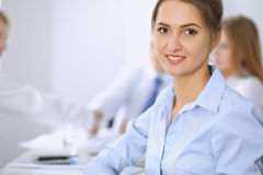 Beautiful business woman on the background of business people Royalty Free Stock Photography