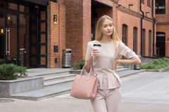 Beautiful Business woman in beige suit Stock Image