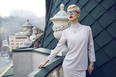 Beautiful business woman blond glasses makeup architecture Royalty Free Stock Photography