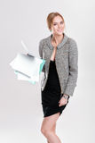 Beautiful business woman blonde in black dress, jacket holding f Stock Image