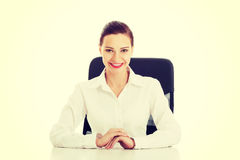 Beautiful business woman, boss sitting on a chair. Stock Photography