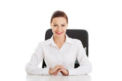 Beautiful business woman, boss sitting on a chair. Royalty Free Stock Image