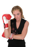 Beautiful Business Woman In Boxing Gloves 2. Attractive blonde executive business woman puts on the boxing gloves to do battle in the corporate world Stock Photos