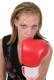 Beautiful Business Woman In Boxing Gloves 3. Attractive blonde executive business woman puts on the boxing gloves to do battle in the corporate world Royalty Free Stock Photo