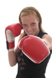 Beautiful Business Woman In Boxing Gloves 6c. Attractive blonde executive business woman puts on the boxing gloves to do battle in the corporate world. Focus is stock photos