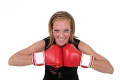 Beautiful Business Woman In Boxing Gloves 7. Attractive blonde executive business woman puts on the boxing gloves to do battle in the corporate world Stock Photo
