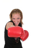 Beautiful Business Woman In Boxing Gloves 8. Attractive blonde executive business woman puts on the boxing gloves to do battle in the corporate world Stock Image