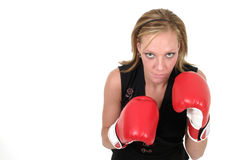 Beautiful Business Woman In Boxing Gloves 8b. Attractive blonde executive business woman puts on the boxing gloves to do battle in the corporate world Royalty Free Stock Image