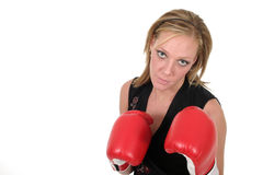 Beautiful Business Woman In Boxing Gloves 9b. Attractive blonde executive business woman puts on the boxing gloves to do battle in the corporate world royalty free stock photography
